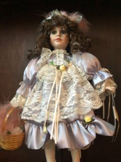Porcelain doll w stand