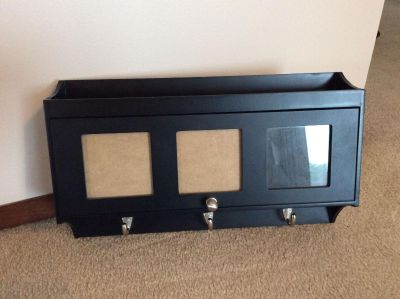 Black wall organizer with 3 photo openings. 10 x 17 x 4 deep. Excellent condition!