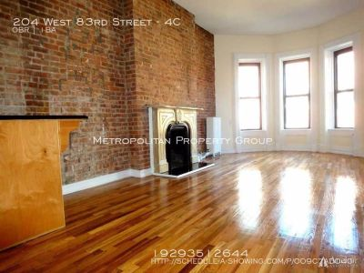 Incredible huge loft Alcove studio with original early-1900s fireplace, hardwood floors, huge curved bay windows with great natural light and exposed brick!