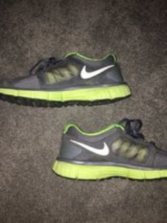 green and grey Nike gym shoes