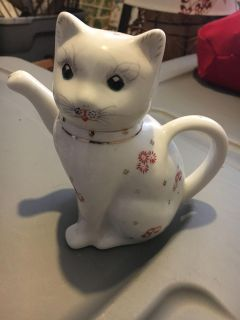 Antique cat creamer. Stands about 7 inches tall