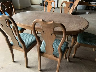 Solid wood table with (6) chairs.