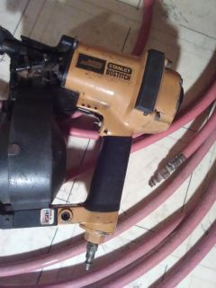 Roofing nail gun with hose