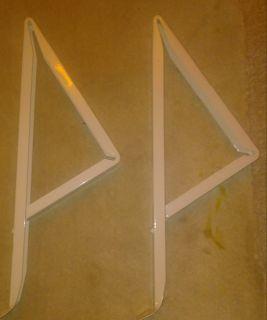 Two AC brackets