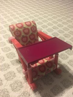 18 inch doll (like American Girl doll) high chair. Can attach to a table. Good condition