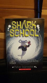 Brand new. Shark school. Chapter book for maybe 3rd, 4th, or 5th. $2