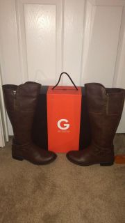 Dark brown riding boots by Guess