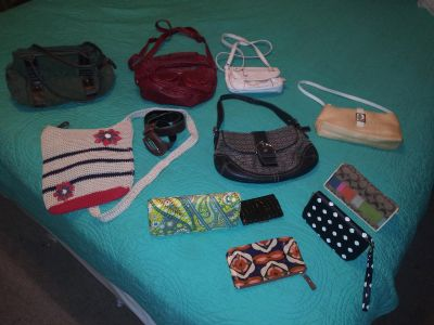 Assortment of name brand wallets and purses package deal