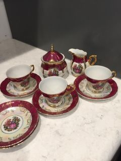 3 China teacups and 5 saucers with creamer and sugar bowl