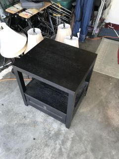 Black end table approx 24 X 24 . Storage on bottom shelf and wide drawer.