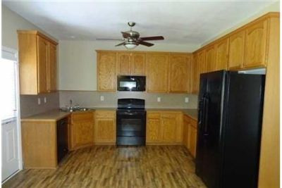 This 3 bed and 2 bath home has 2, 005 feet of living space. Dog OK!