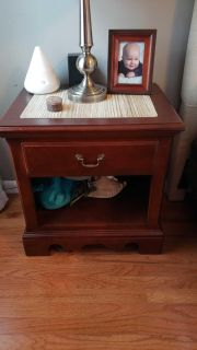 Cherry nightstands by Thomasville there are 2