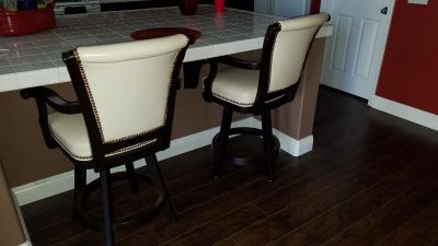 Mikhail Darafeev leather and maple barstools