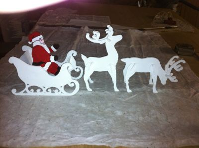2 small deer with santa and sleigh