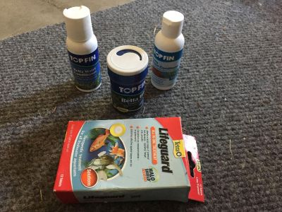 Beta fish supplies (food, 2 water conditioners, lifeguard)