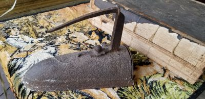 antique sad iron with place for hot coal