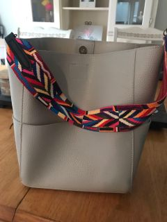 Grey tote with short guitar strap