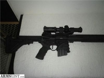 "For Sale: AR15 450 Bushmaster 20"" Rifle. Many quality extras"