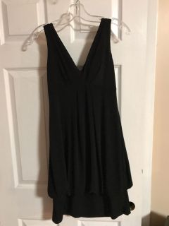 Gorgeous little black dress. Check out the back! Size 6, but stretchy. EUC