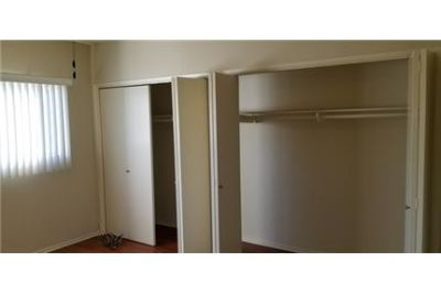 1 bedroom Apartment - Upstairs unit Gated building, stove.