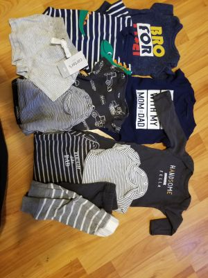 Bunches of newborn clothes