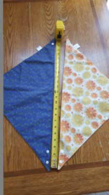 Two reversible dog bandanas