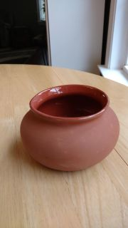 """Small clay flower pot measures 6"""" wide and 3 1/2"""" tall"""