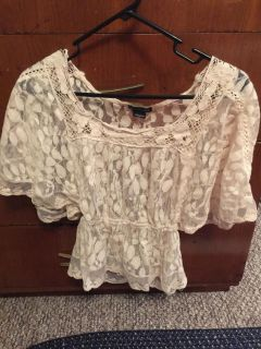 Juniors size small lace shirt. See thru, cute over another shirt or tank. Gathered at waist