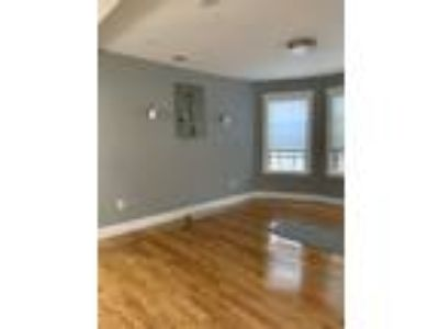 This great Three BR, One BA sunny apartment is located in the Mission Hill area