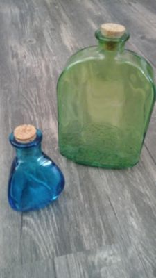 2 Colored Glass Bottles. . FREE