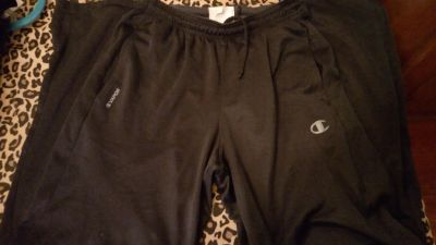Champion Brand BLACK sweat pants with fleece inside & nylon outside. Has Doubledry and pockets Size small GUC zippers up leg bottoms