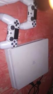 PS4 with 2 controls and 2018 FIFA