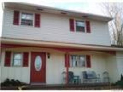 Real Estate Rental - Four BR, 1 1/Two BA Colonial
