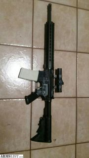 For Sale: AR-15 Bushmaster w/red dot