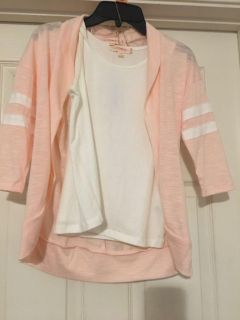 Grey or peach cardigan with white tank top underneath