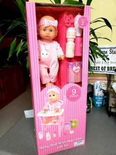Brand New. Baby Doll with High Chair and accessories Gift Set. The box measures 24in high.