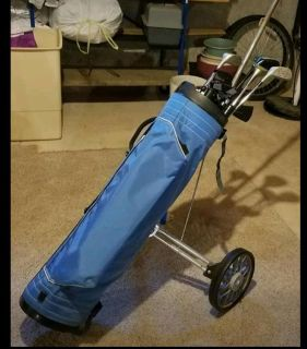 Golf bag with cart and golf clubs
