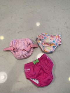 Lot of swim diapers size 6 months.