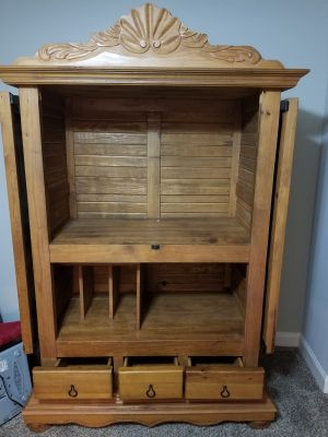 Very heavy solid wood entertainment center. Measures 55in.wide, TV opening 50 in