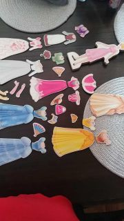 Lots of Cinderella wood and magnetic clothing with 1 doll