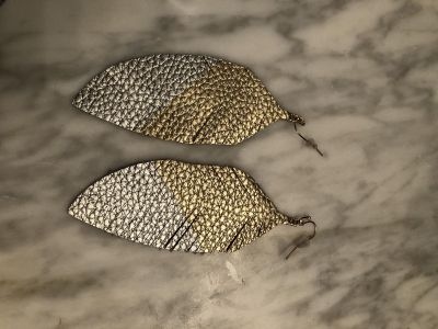 Silver and gold leather earrings.