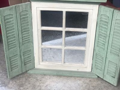 Decorative mirror with shutters