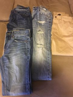 Three pair of American Eagle jeans and one pair of khakis