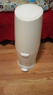 Playtex Diaper Genie Elite along with a diaper changing pad(look in description for more)