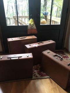 Four vintage suit cases. Firm on the price