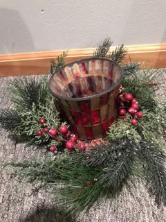 Holiday table decor with candle vase