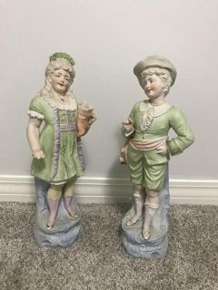 Lady and Gentleman figurines.