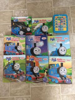 Thomas the train read along books, electronic pad reads the book, needs new batteries but everything in great shape!