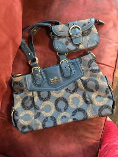 Coach set. I m not sure if it s authentic as it was a gift so price reflects this. 2 pc set.