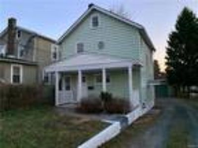 Real Estate For Sale - Four BR, 1 1/Two BA Two story